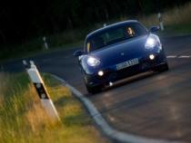 2007-Porsche-Cayman-Blue-Front-Drive-Tilt-1920x1440